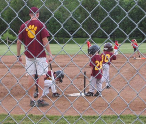 06-08-2010_10_gets_a_hit_and_teammate_comes_in_for_a_slide_at_home